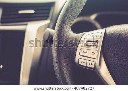 Switch control on steering wheel copy space warm retro tone - stock photo