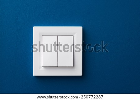 switch-gang white on blue wall - stock photo