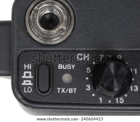 Switch on a handheld two way radio to turn up the power - stock photo