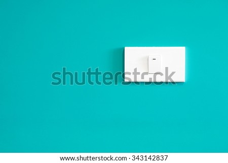switch on green wall - stock photo