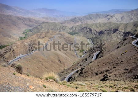 switchbacks in the mountains of the High Atlas in Morocco - stock photo