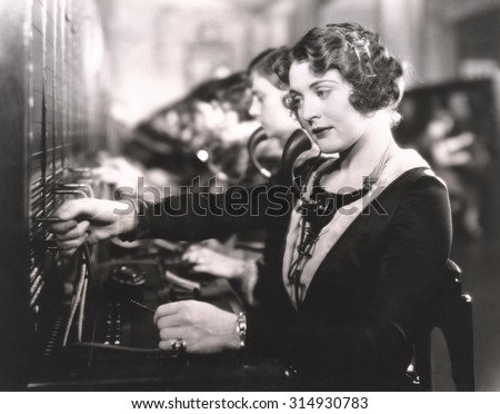 Switchboard operators at work - stock photo