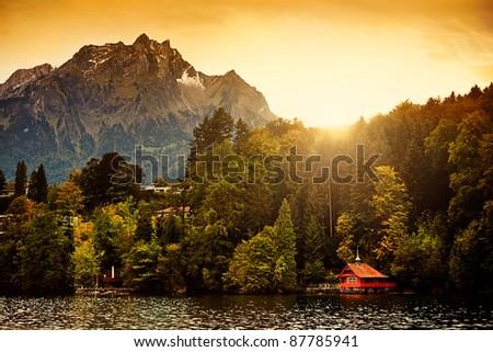 Switzerland Alps Sunrise on Lucerne Lake with Mount Pilatus in the background. - stock photo
