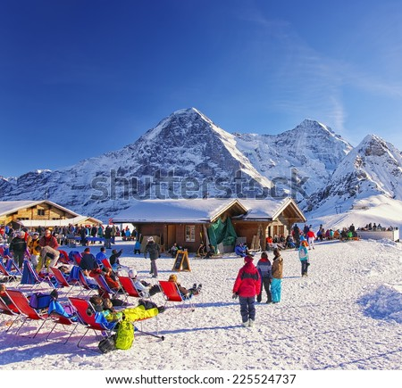 Switzerland, Bern Highland, People relaxing at the outdoor lounge on winter sport resort  in Bern region n swiss alps, New Year eve, Switzerland, Bern highland region, December 31, 2013   - stock photo
