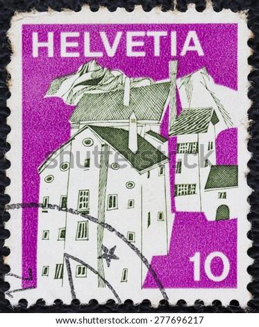 "SWITZERLAND - CIRCA 1973: A stamp printed in Switzerland, shows view of Graubunden village, from the series ""Villages"", circa 1973 - stock photo"