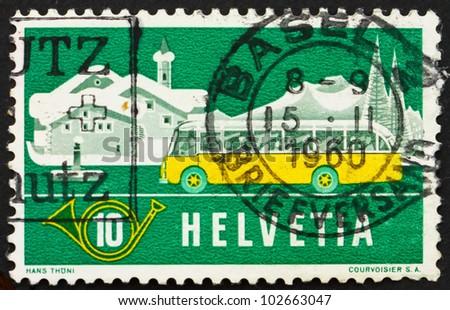 SWITZERLAND - CIRCA 1953: a stamp printed in the Switzerland shows Alpine Post Bus, Winter Background, circa 1953 - stock photo