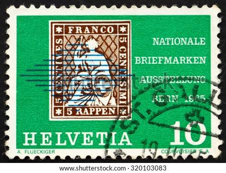 SWITZERLAND - CIRCA 1965: a stamp printed in the Switzerland shows Seated Helvetia, from 1854, National Postage Stamp Exhibition, Bern, circa 1965 - stock photo
