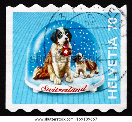 SWITZERLAND - CIRCA 2000: a stamp printed in the Switzerland shows St. Bernard Dog, Souvenir in Snow Dome, circa 2000 - stock photo