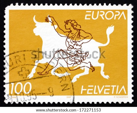 SWITZERLAND - CIRCA 1995: a stamp printed in the Switzerland shows Zeus Disguised as Bull, Abducting Europa, Daughter of King of Phoenicia, circa 1995 - stock photo