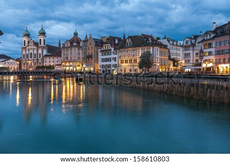 Switzerland, Lucerne, Reuss river (in the evening after the rain). - stock photo