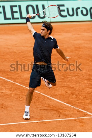 Switzerland?s top ranked tennis player Roger Federer during the match at Roland Garros (French Open). Paris, May 2008. - stock photo