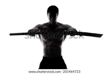 Sword. Silhouette of strong man with sword.Isolated - stock photo