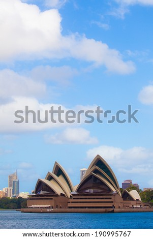 SYDNEY - APR 6: Sydney Opera House under blue sky on April 6, 2009 in Sydney. The Iconic Sydney Opera House is a multi-venue performing arts centre also containing bars and outdoor restaurants. - stock photo