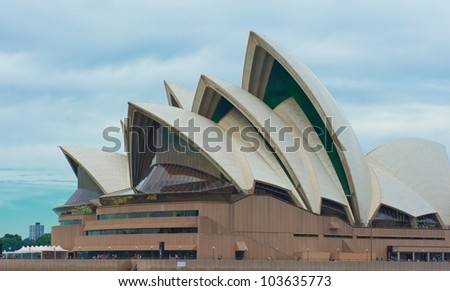 SYDNEY - APRIL 22: Sydney Opera House view on April 22, 2012 in Sydney, Australia. The Sydney Opera House is a famous arts center. It was designed by Danish architect Jorn Utzon, opening in 1973. - stock photo