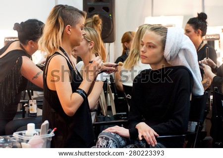 SYDNEY AUSTRALIA - APRIL 14 2015: Model has hairstyle, manicure and makeup during Lee Matthews fashion show backstage at Mercedes Benz Fashion Week in Carriageworks Sydney Australia.  - stock photo