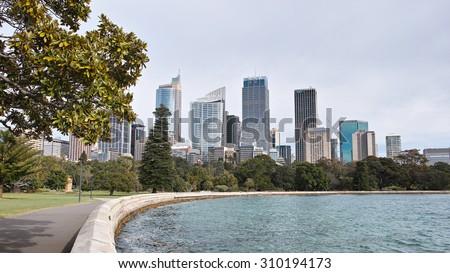 SYDNEY, AUSTRALIA - Aug. 5, 2015:: Sydney CBD  skyscrapers view from Royal Botanic Gardens. - stock photo