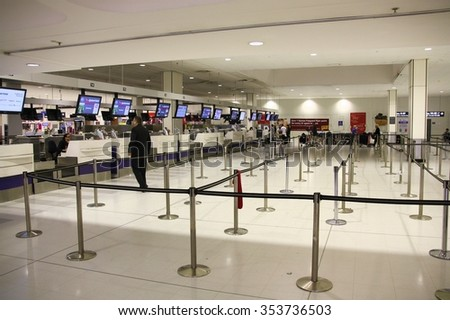 SYDNEY, AUSTRALIA - FEBRUARY 15, 2008:  Passengers check in at Sydney Kingsford Smith Airport. The airport handled 327,190 aircraft movements in FY 2013-14. - stock photo