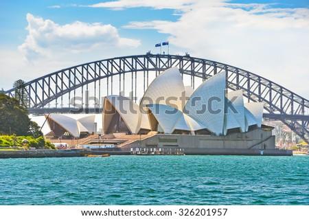 Sydney, Australia - January 23: Sydney Harbor Bridge and Opera House in a sunny day on January 23, 2015 in Sydney, Australia.  - stock photo
