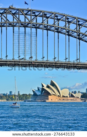 Sydney, Australia - January 25: Sydney Opera House and Harbor Bridge in the afternoon on January 25, 2015 in Sydney, Australia.  - stock photo