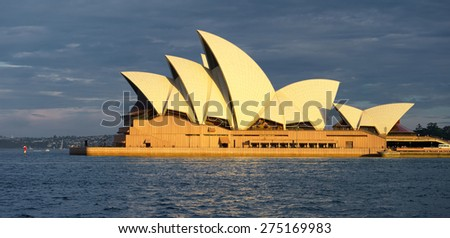 SYDNEY, AUSTRALIA - JANUARY 1, 2015: The Iconic Sydney Opera House is a multi-venue performing arts centre also containing bars and outdoor restaurants. JANUARY 1, 2015 in Sydney, Australia. - stock photo