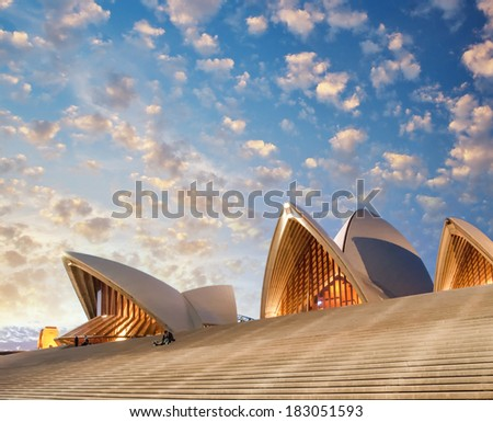SYDNEY, AUSTRALIA - JUL 28, 2010: Sunset over Opera House Architecture. The Iconic Sydney Opera House is a multi-venue performing arts centre also containing bars and outdoor restaurants. - stock photo