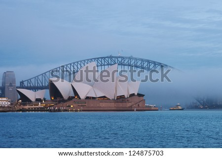 SYDNEY, AUSTRALIA - JULY 10 : Sydney Harbour Bridge that carries rail, vehicular, bicycle and pedestrian traffic and Sydney Opera House, a multi-venue arts center. Picture taken on July 10, 2012. - stock photo