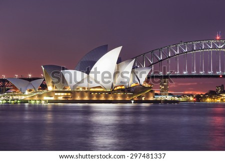 SYDNEY, AUSTRALIA, 10 JULY 2015 - Sydney opera house and Harbour bridge in Sydney at sunset. Iconic and world famous landmark of Australia viewed from Mrs Macquarie point in Royal Botanic Garden - stock photo