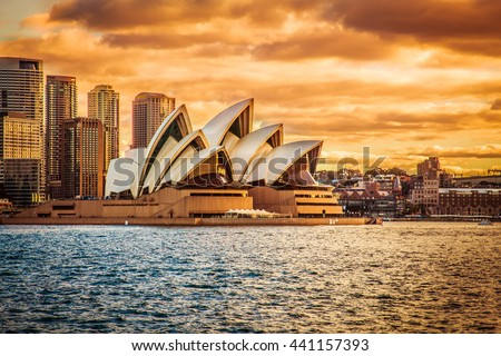 SYDNEY AUSTRALIA - 16 JUNE, 2013 : Opera House view with beautiful sky from ferry in evening on 16 June, 2013 in Sydney, Australia. - stock photo