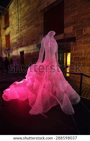 SYDNEY, AUSTRALIA -JUNE 2, 2015;  The Dresses shapes hundreds of fibre-optic strands into the form of three beautiful and extravagant dresses.   Artist Tae Gon Kim - stock photo