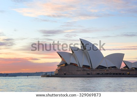 SYDNEY, AUSTRALIA - JUNE 23, 2015;  The Sydney Opera House and beautiful winter sunrise.  Popular destination in Sydney for tourists visiting Australia - stock photo