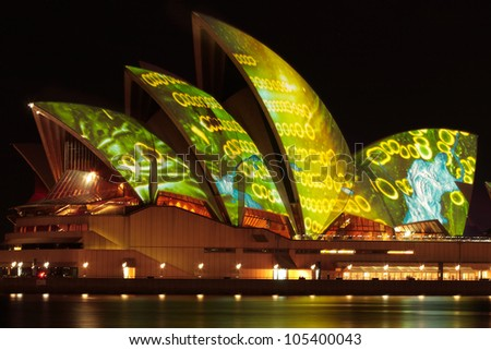 SYDNEY AUSTRALIA - JUNE 14, 2009  The Sydney Opera House illuminated with spectacular art by various artists during the annual Vivid Sydney Festival on June 14, 2009 - stock photo