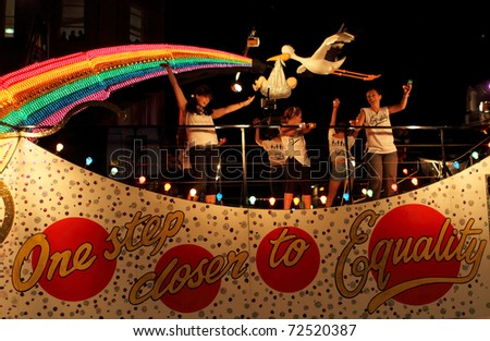 SYDNEY, AUSTRALIA - MARCH 5: Some women dance on the big car at parade on March 5, 2011 for Mardi Gras in Oxford Street, Sydney, Australia. Mardi gras is an annual event for gay/lesbian acceptance. - stock photo