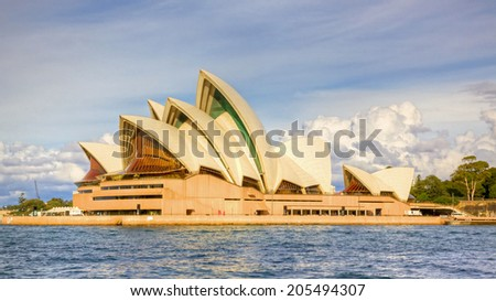 SYDNEY, AUSTRALIA - MAY 20, 2010: A view of Sydney Opera House from the water. With its interlocking roof or 'shells' it is Australia's most recognisable building and a UNESCO World Heritage Site. - stock photo