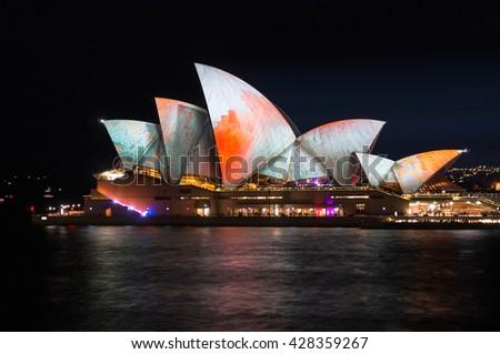 Sydney, Australia - 2016, May 27: Annual outdoor lighting festival Vivid Sydney: Festival of Light, Music & Ideas. Sydney Opera House illumination Lighting the Sails Songlines. Long Exposure - stock photo