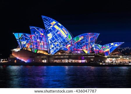 Sydney, Australia - May 27, 2016: Annual outdoor lighting festival Vivid Sydney: Festival of Light, Music and Ideas. Sydney Opera House illumination Lighting the Sails Songlines. Long Exposure - stock photo