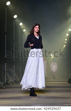 SYDNEY / AUSTRALIA â?? MAY 16: Model walks on runway during AJE urban female fashion collection Apocalyptic Paradise during Mercedes Benz Fashion Week Australia on 16 May 2016 in Carriageworks in Sydney - stock photo