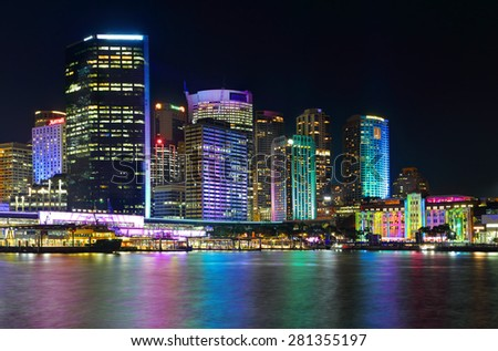 SYDNEY, AUSTRALIA - MAY 25, 2015; Sydney city CBD and Circular Quay by night.  Buildings illuminated with colour during Vivid Sydney annual festival event. - stock photo