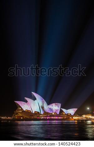 SYDNEY, AUSTRALIA - MAY 29: Sydney Opera House shown during Vivid Sydney: A Festival of Light, Music & Ideas on May 29, 2013 in Sydney, Australia. - stock photo
