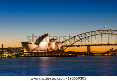 Sydney, Australia - May 16, 2014: The Sydney Opera House with Harbour bridge in Sydney Australia, Designed by Danish architect Jorn Utzon - stock photo