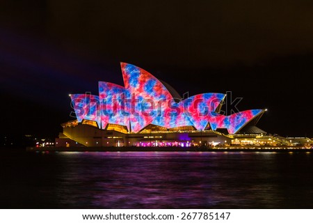SYDNEY, AUSTRALIA - MAY 29, 2014: Vivid Sydney is an annual outdoor lighting festival with immersive light installations and projections. It includes performances from local & international musicians. - stock photo