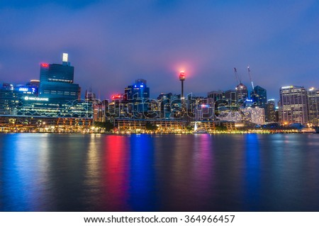 SYDNEY/AUSTRALIA - NOV 22, 2014 : Darling Harbour and King street wharf at night with illuminated skyscrapers of Central Business District. Darling Harbour is a popular place among locals and tourists - stock photo