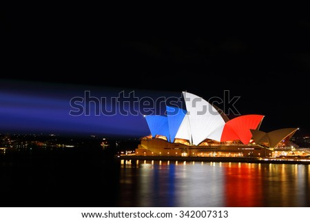 SYDNEY, AUSTRALIA - NOVEMBER 16, 2015;  Sydney Opera House lit up in colours of the French flag... blue, white and red in support of  tragic terrorist events in France  by an islamic extremist group  - stock photo