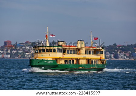 SYDNEY,AUSTRALIA - OCTOBER 24,2014: One of Sydney's iconic ferries heads towards Taronga Zoo. The 28 vessels handle a total of 15 million passenger trips per year. - stock photo