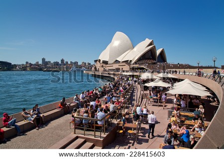 SYDNEY,AUSTRALIA - OCTOBER 19,2014: People eat and drink at Opera Bar. With harbour views and live music, it is one of Sydney's most popular destinations. - stock photo