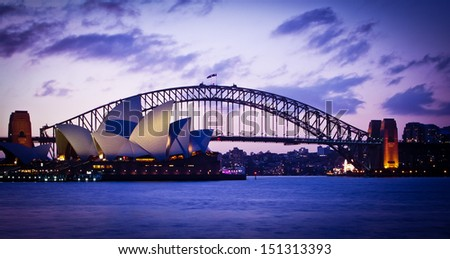 SYDNEY, AUSTRALIA - SEPT 1 : Sydney's most famous icons, the Sydney Opera House and Harbour Bridge  The Opera House celebrate its 40th anniversary in 2013 - September , 2007in Sydney, Australia. - stock photo