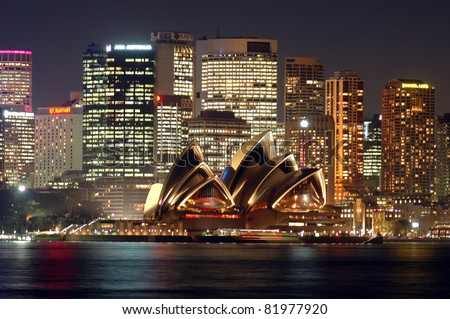SYDNEY, AUSTRALIA - SEPTEMBER 29: Sydney Opera House on September 29, 2006 in Sydney, Australia. The Sydney Opera House hosts over 1,500 performances each year that are attended by approximately 1.2 million people. - stock photo