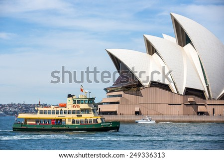 Sydney, Australia - September 19: View of a passenger ferry near the Opera House in Sydney, Australia on September 19, 2014. - stock photo