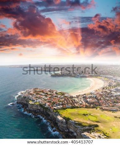 Sydney Bondi Beach. Sunset aerial view from helicopter. - stock photo