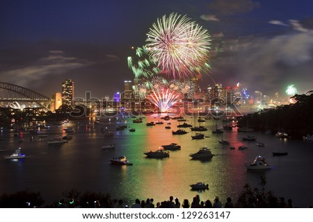Sydney city family firework new year eve celebration illumination art pyrotechnics with reflection of bright lights in sydney harbour waters - stock photo