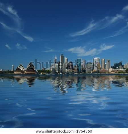 Sydney City Skyline Reflect in Sydney Harbour Waters - stock photo